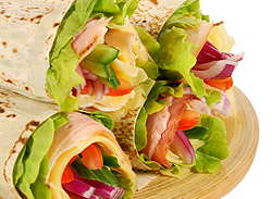 tasty lunch wrap with turkey